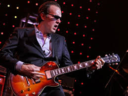 Joe Bonamassa on stage with guitar